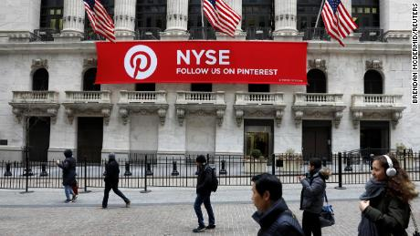 A Pinterest banner hangs on the facade of the New York Stock Exchange during the morning rush in February 2018. Pinterest is expected to go public later this month.