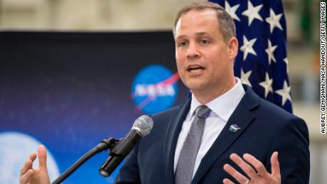 CAPE CANAVERAL, FL - MARCH 11: In this handout photo provided by NASA, NASA Administrator Jim Bridenstine talks to employees about the agencys progress toward sending astronauts to the Moon and on to Mars during a televised event at the Neil Armstrong Operations and Checkout Building at NASA's Kennedy Space Center on March 11, 2019 in Cape Canaveral, Florida.  NASA's Orion spacecraft, which is scheduled to be flown on Exploration Mission-2, was on display during the event. (Photo by Aubrey Gemignani/NASA via Getty Images)