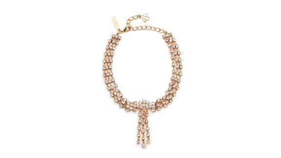 "<strong>Oscar de la Renta Gold Crystal Tassel Collar (prices vary based on subscription; </strong><a href=""http://redirect.viglink.com?type=bk&opt=false&u=https%3A%2F%2Fwww.renttherunway.com%2Fshop%2Fdesigners%2Foscar_de_la_renta%2Fgold_crystal_tassel_collar&key=ed7eb6546c416eb284920d7a87c6d8c4"" target=""_blank"" target=""_blank""><strong>renttherunway.com</strong></a><strong>)</strong>"