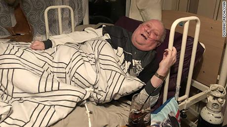 Peter Naylor in his bed in Bilborough, Nottingham.