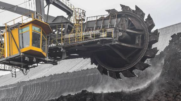 """Picture taken on January 23, 2019 shows a bucket wheel excavator mining lignite from the Welzow-Sued brown coal opencast mine in Welzow, eastern Germany. - The so-called """"Kohlekommission"""" (coal commission), a governmental commission for growth, structural change and employment, that is meeting in Berlin on January 25, 2019, is to announce a roadmap for exiting coal as part of efforts to make Germany carbon-neutral by 2050. (Photo by Patrick Pleul / dpa / AFP) / Germany OUT        (Photo credit should read PATRICK PLEUL/AFP/Getty Images)"""