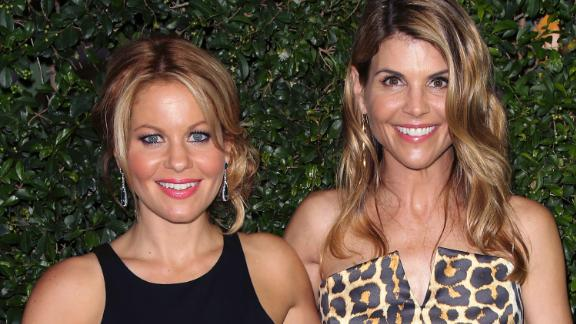 Actresses Candace Cameron Bure, left, and Lori Loughlin on July 29, 2015, in Beverly Hills.