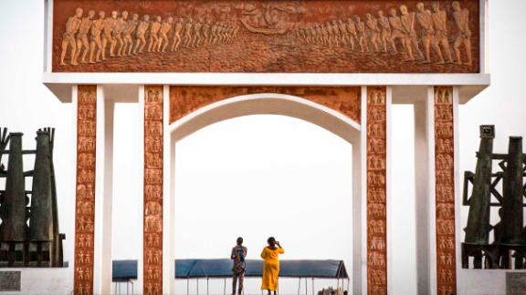 OUIDAH, BENIN - JANUARY 12, 2018: Visitors take pictures  at the Point of No Return, where three million slaves were shipped to the Americas, in Ouidah, Benin on Friday, January 12, 2018. (Photo by Jane Hahn for The Washington Post via Getty Images)