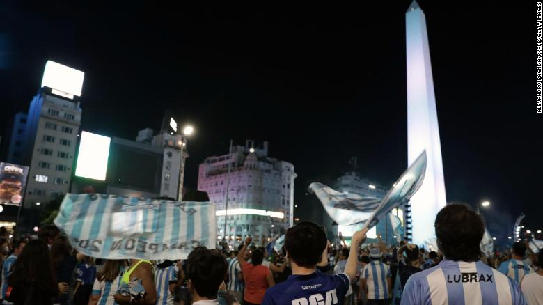 Racing Club fans celebrate at the Obelisk in Buenos Aires.