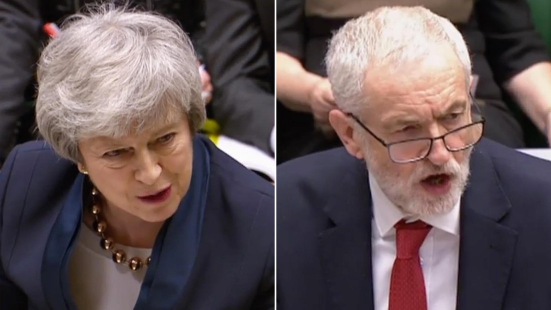 Theresa May, left, and Jeremy Corbyn, right, debate in the House of Commons in London on Wednesday, April 3.