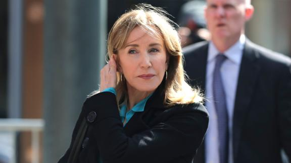 Actress Felicity Huffman arrives Wednesday at federal court in Boston.