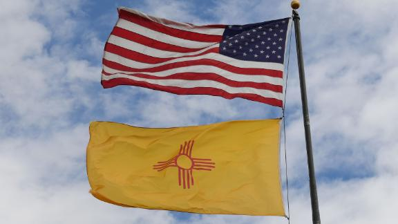 The US and New Mexico flags fly before the upcoming mid-term elections in Albuquerque, New Mexico on October 1, 2018. (Photo by Mark RALSTON /AFP/Getty Images)