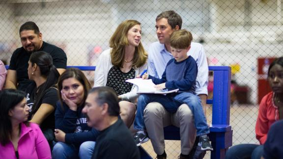 O'Rourke and his wife sit with their son Ulysses as they watch their daughter, Molly, play volleyball in February 2017.