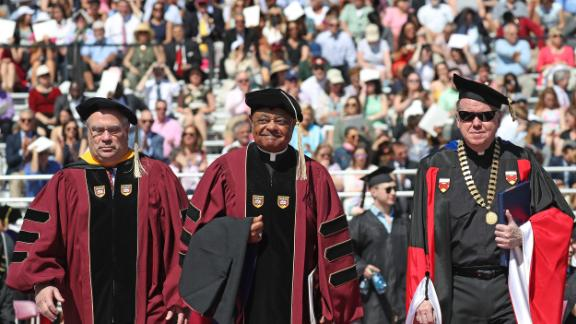 From left, Peter K. Markell, Archbishop Wilton Gregory and the Rev. William P. Leahy, S.J., at the Boston College commencement in 2018.