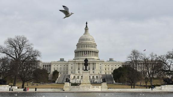 TOPSHOT - The US Capitol is seen in Washington, DC on January 22, 2018 after the US Senate reached a deal to reopen the federal government, with Democrats accepting a compromise spending bill.