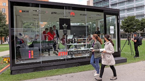 Students working in a glass cube on the Massachusetts Institute of Technology campus in 2018. The university is suspending ties with Huawei and ZTE.