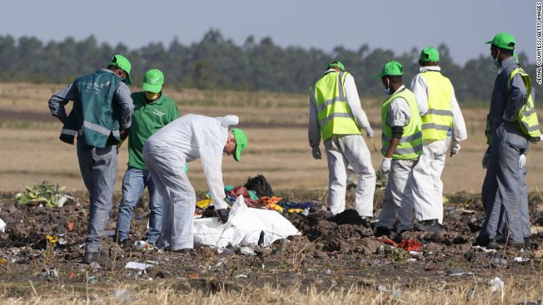 Investigators collect personal effects and other materials from the crash site of Ethiopian Airlines Flight 302.