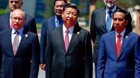 Russian President Vladimir Putin, Chinese President Xi Jinping,  Indonesia's President Joko Widodo and other delegation heads pose for a group photo as they attend the Belt and Road Forum for International Cooperation at the Yanqi Lake venue on May 15, 2017, on the outskirts of Beijing, China.