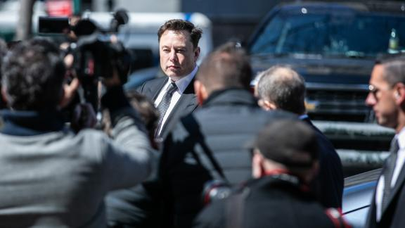 Elon Musk, chief executive officer of Tesla Inc., arrives at federal court in New York, U.S., on Thursday, April 4, 2019. The SEC says Musk violated his agreement with the agency when he tweeted on February 19 that Tesla would make about half a million cars in 2019, before tweeting a few hours later that deliveries would only reach about 400,000. Photographer: Jeenah Moon/Bloomberg via Getty Images