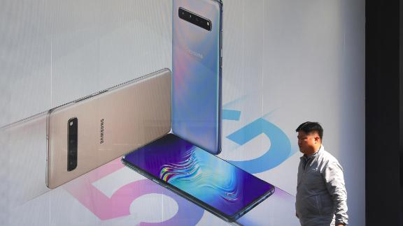 A man walks past an advertisement for the Samsung Galaxy S10 5G smartphone in Seoul on April 4, 2019. - South Korea launched the world