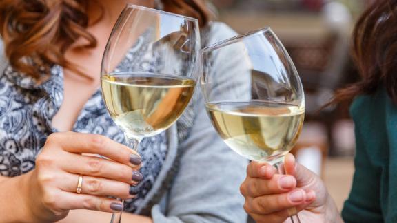 Glasses of wine in the hands of women; Shutterstock ID 496584514; Job: -