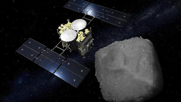 An artist's impression of the Hayabusa probe arriving at the Ryugu asteroid.