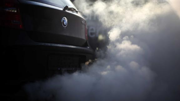 FILED - 21 February 2018, Germany, Wickede: View of the  exhaust pipe and its smoke from a BMWin a factory in Wickede. As sixth biggest car manufacturer BMWnow faces a USlawsuit for apparent exhaust deceptions in diesel cars. Photo: Ina Fassbender/dpa (Photo by Ina Fassbender/picture alliance via Getty Images)