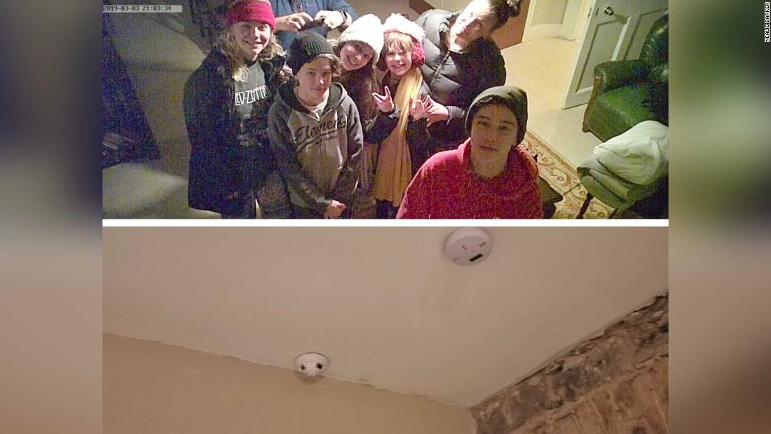 Family takes photo with hidden camera found in Airbnb