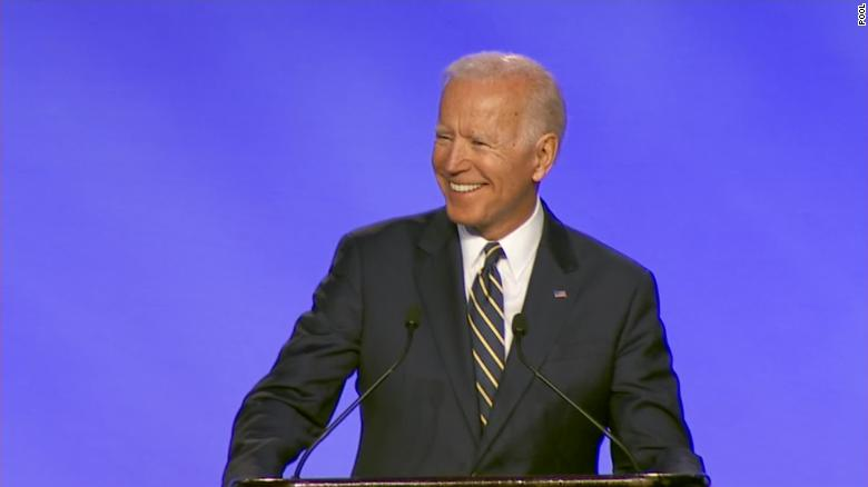 Biden jokes he had permission to hug union official