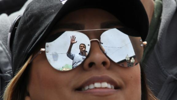 O'Rourke is reflected in a supporter's sunglasses as he speaks during a campaign rally in El Paso in March 2019.