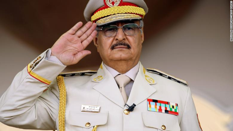 Libya's Khalifa Haftar salutes during a military parade in the eastern city of Benghazi on May 7, 2018.