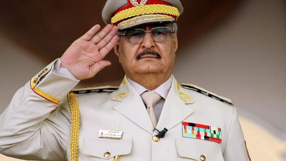 General Khalifa Haftar salutes during a military parade in Benghazi on May 7, 2018.