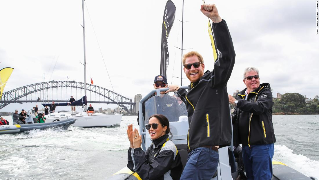 While in Sydney, Meghan and Harry cheer on sailors during the Invictus Games in October.