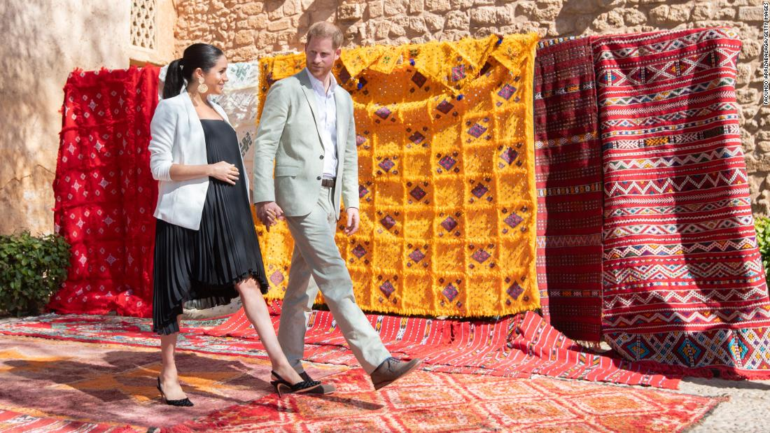 Meghan and Harry walk past tapestries on display at the Andalusian Gardens during a visit to Rabat, Morocco, in February.