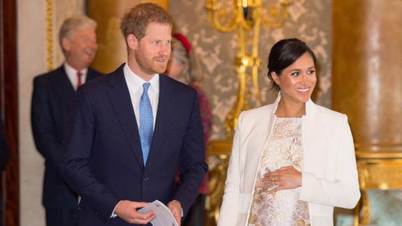 Britain's Prince Harry, Duke of Sussex, (L) and Britain's Meghan, Duchess of Sussex (R) attend a reception to mark the 50th Anniversary of the investiture of The Prince of Wales at Buckingham Palace in London on March 5, 2019. - The Queen hosted a reception to mark the Fiftieth Anniversary of the investiture of Britain's Prince Charles, her son, as the Prince of Wales. Prince Charles was created The Prince of Wales aged 9 on July 26th 1958 and was formally invested with the title by Her Majesty The Queen on July 1st 1969 at Caernarfon Castle.