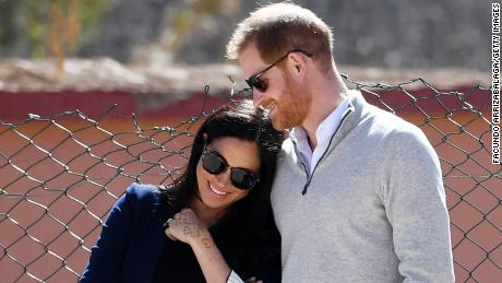 Meghan, Duchess of Sussex and Prince Harry, Duke of Sussex, as students on February 24 2019 in Asni, Morocco, watch football play.