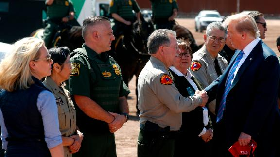 President Donald Trump visits a new section of the border wall with Mexico in Calexico, Calif., Friday April 5, 2019. at left is Homeland Security Secretary Kirstjen Nielsen. (AP Photo/Jacquelyn Martin)