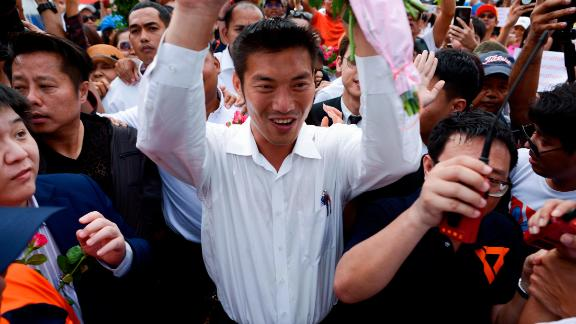 Thailand's Future Forward Party leader Thanathorn Juangroongruangkit is mobbed by his supporters at a police station in Bangkok on Saturday.