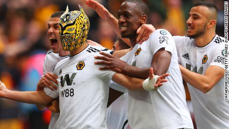 Raul Jimenez dons a mask after scoring for Wolves in the FA Cup semifinals.