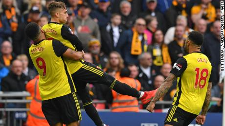 Troy Deeney lifts Gerard Deulofeu in joy during Watford's FA Cup semifinal win over Wolves.