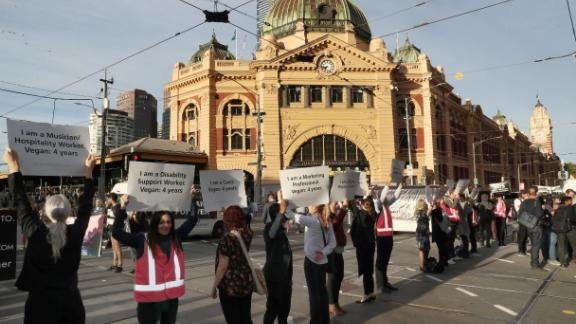 Animal rights protesters block the intersection of Flinders and Swanston streets during a demonstration Monday in Melbourne, Australia.