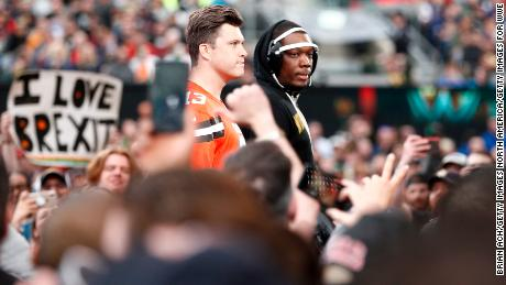 SNL's Michael Che and Colin Jost enter the ring at WWE WrestleMania at Met Life Stadium.
