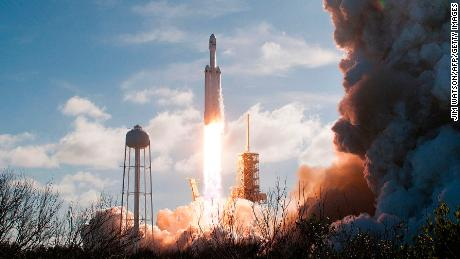 The SpaceX Falcon Heavy launches from Pad 39A at the Kennedy Space Center in Florida, on February 6, 2018, on its demonstration mission. The world's most powerful rocket, SpaceX's Falcon Heavy, blasted off Tuesday on its highly anticipated maiden test flight, carrying CEO Elon Musk's cherry red Tesla roadster to an orbit near Mars. Screams and cheers erupted at Cape Canaveral, Florida as the massive rocket fired its 27 engines and rumbled into the blue sky over the same NASA launchpad that served as a base for the US missions to Moon four decades ago.