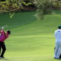Masters photos A-Z caddies 13th Patrick Reed