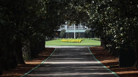 The exclusive driveway to Augusta's historic clubhouse is framed by dozens of magnolia trees. Only members and Masters competitors are allowed to access this revered entrance which gives on to the Founder's Circle and then the whitewashed concrete clubhouse, built in 1854.