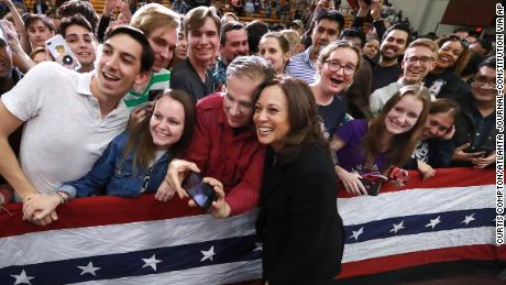 U.S. Senator Kamala D. Harris, D-California, pauses for a selfie with supporters while working the crowd after her speech while holding a campaign rally at Morehouse College on Sunday, March 24, 2019, in Atlanta. The Democratic candidate for president is at least the fifth presidential candidate to visit Georgia in the 2020 cycle. (Curtis Compton/Atlanta Journal-Constitution via AP)