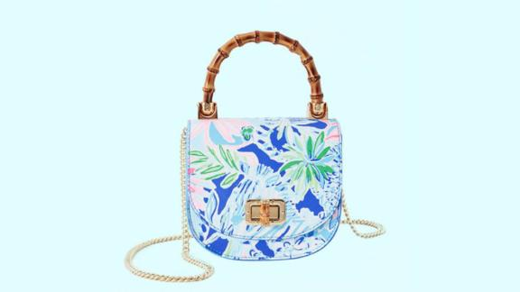 """<strong>Leilani Bamboo Top Handle Mini Bag ($138; </strong><a href=""""https://click.linksynergy.com/deeplink?id=Fr/49/7rhGg&mid=41728&u1=0518personalitymothers&murl=https%3A%2F%2Fwww.lillypulitzer.com%2Fleilani-bamboo-top-handle-mini-bag%2F000773.html%3F"""" target=""""_blank"""" target=""""_blank""""><strong>lillypulitzer.com</strong></a><strong>)</strong><br />"""
