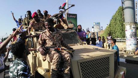Sudanese troops move to protect anti-government protesters in Khartoum