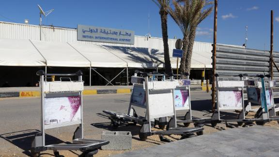 Luggage trolleys lie in front of the gate of the Mitiga airport after it was attacked Monday.