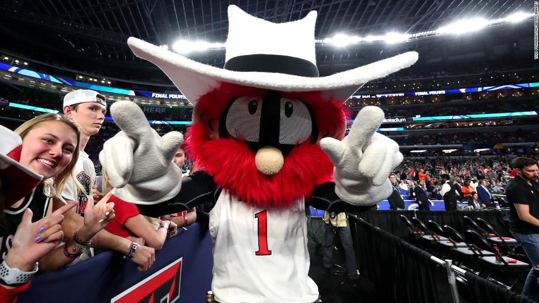 "Texas Tech's mascot, Raider Red, does the school's ""guns up"" salute."