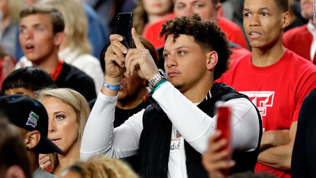 Patrick Mahomes, the NFL's Most Valuable Player this past season, takes pictures before the start of the game. Mahomes played football at Texas Tech.