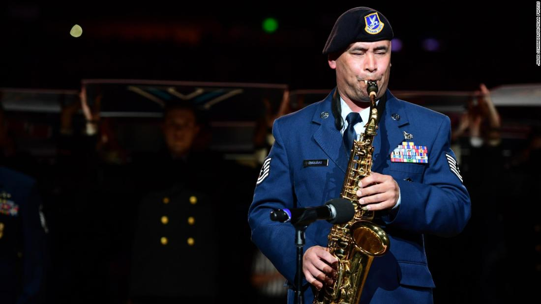Air Force Tech Sgt. Johnny Holliday plays the National Anthem on the saxophone.