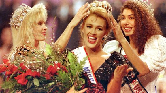 Miss California Shannon Marketic, center, reacts as she is crowned Miss USA 1992.
