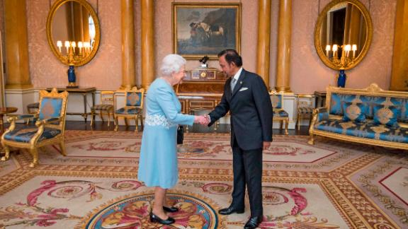 Britain's Queen Elizabeth II meets the sultan of Brunei at Buckingham Palace in 2017.