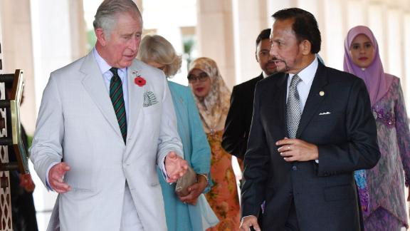 Britain's Prince Charles walks with the sultan of Brunei as they attend a high tea at the sultan's palace in Bandar Seri Begawan, Brunei, in 2017.
